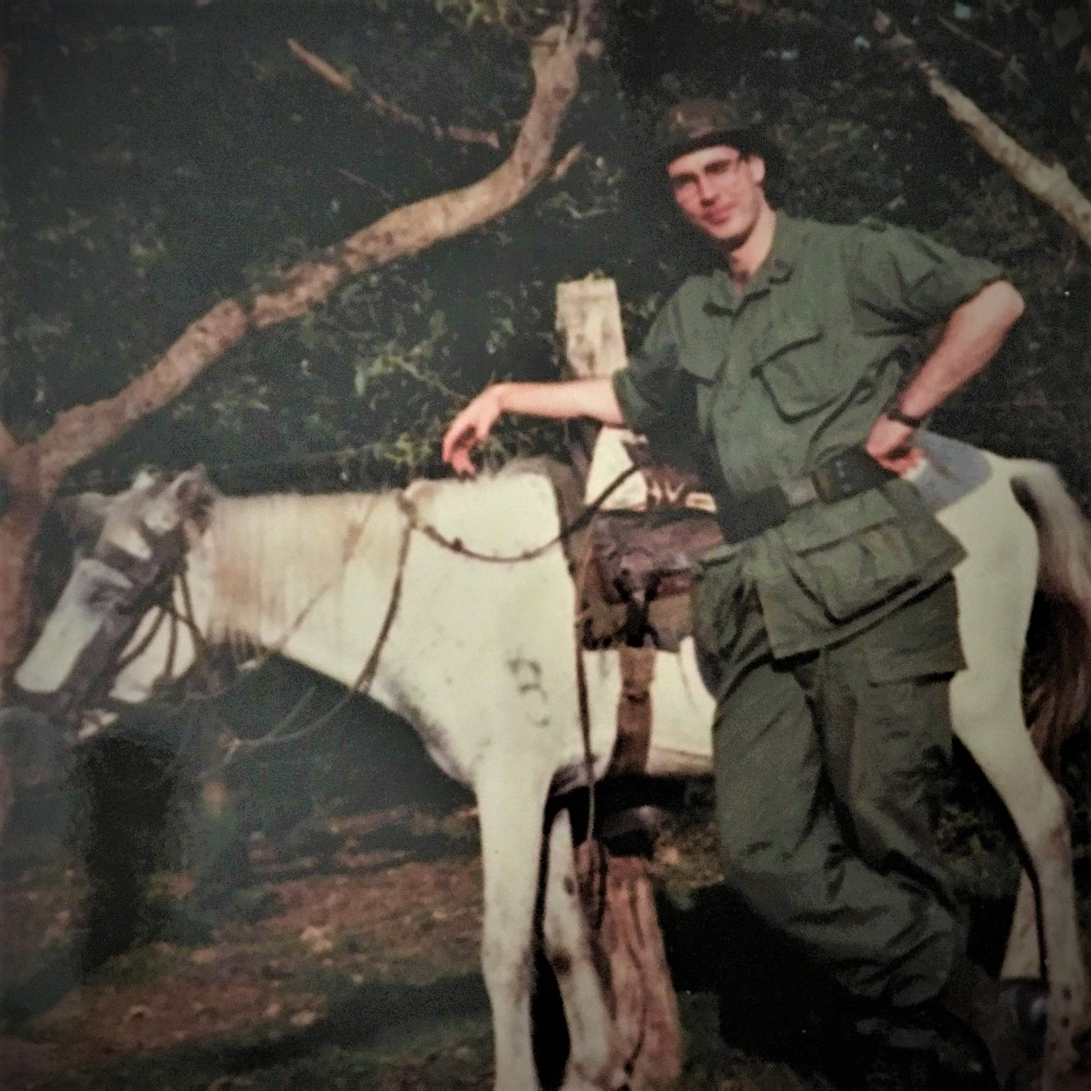 Fran O'Connell older picture in the jungle with a horse